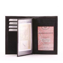 Valódi bőrből készült fekete színű, álló minőségi irattartó pénztárca. Papírpénztartókkal, kártyatartó és oldalra kihajtható rekeszekkel.